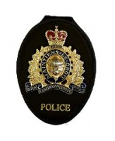 Recessed neck or belt badge holder for RCMP cap badge